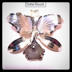 Gold toned orchid brooch